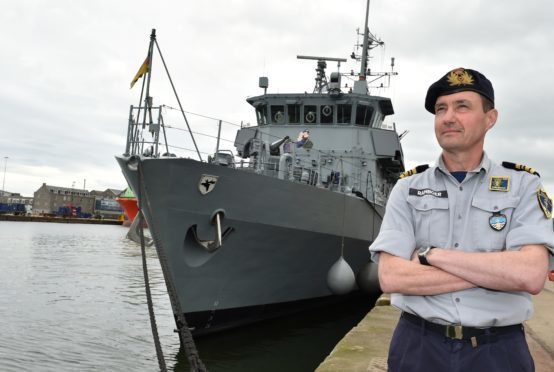 Commander Peter Ramboer (Belgian Navy) at Aberdeen Harbour with the German Navy's Frankenthal-class mine hunter FGS Bad Bevensen in the background. Picture by Colin Rennie