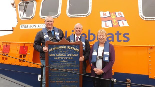 Keith Webb (centre) presents a Newvburgh-on-Ythan Lifeboat Station service board dated 1889 to Bill Deans (left), Aberdeen Lifeboat operations manager and Bec Allen (right), honorary secretary of Aberdeen branch, RNLI