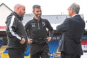 Ross County interim co-managers Stuart Kettlewell (C) and Steven Ferguson (L) chat with chairman Roy MacGregor