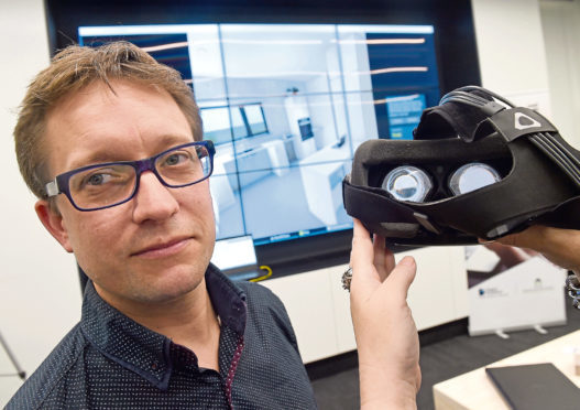 Matt Stevenson of Carbon Dynamic, based in Invergordon with the virtual reality version of a home they are developing for Albyn Housing.  The event was held yesterday at the HIE enterprise and research facility on the UHI Campus. Picture by Sandy McCook