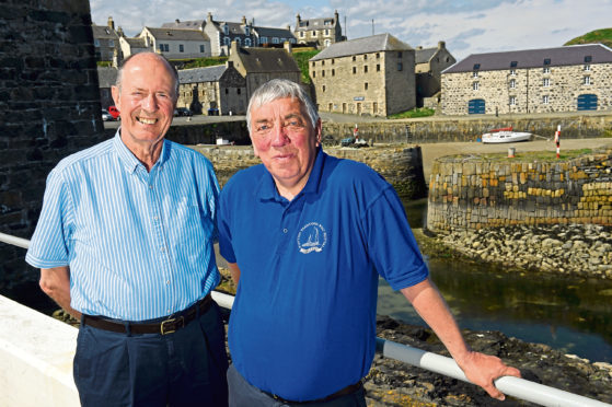 Organisers Roger Goodyear, left, and Keith Newton as Portsoy is made ready to host its 25th boat festival. Photograph by Kenny Elrick