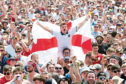 England supporters and festival goers watch England v Panama during the Isle of Wight festival at Seaclose Park, Newport