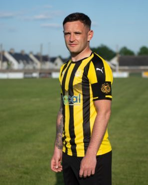 Gregg Main, pictured in Nairn County's new 2018-19 strip, will have his testimonial game at the end of the month.