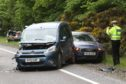 Scene of a three-vehicle crash on the A96 near Inverness Airport.