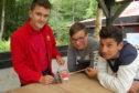 Andrew Milton, carpenter at Dumfries House, with Hazlehead pupils Kieran Hadden (15) and Hadi Hamada (16).