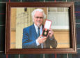 A framed photo left by comedian Billy Connolly after his stay at Kincraig Castle Hotel.