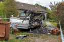 A caravan was completely burnt out by firebugs on Monday evening.