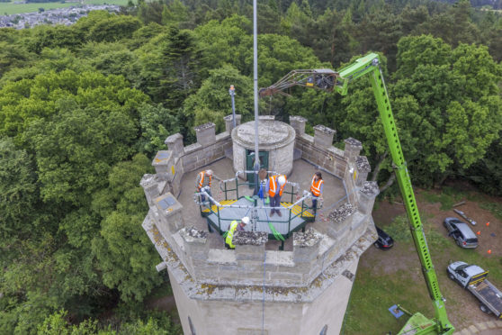 AJ Engineering installed a viewing platform on the roof of Nelson's Tower in Forres, using a telescopic crane. Picture: Marc Hindley