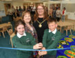 Pupils at Milne's Primary School get tour of £2million extension, which has been completed in time for last day of term.  Pictured: Hannah Stewart-Sutherland P7, Sonya Warren, chairwoman of Moray Council's children and young people services commitee, council convener Shona Morrison, P7 pupil  Tavis Thomson.