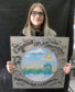 Millburn pupil Anna-Evalina holding the prototype for the HighlandAR Nessie plaque