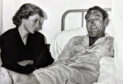 Sandy McCook's photo of Princess Diana at the bedside of survivor Michael Bradley at ARI.