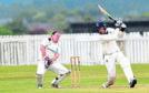Stoneywood wicket keeper Martin Reid with Falkland batsman Cameron Nellies.