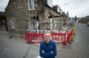 Philip Murray outside his parents' house in Rothes.