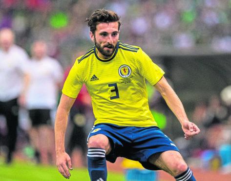 Graeme Shinnie in action for Scotland against Mexico.