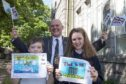 Lord Provost Barney Crockett with Armed Forces Day flag competition winner Maya Maclean and runner-up Matthew Marr.