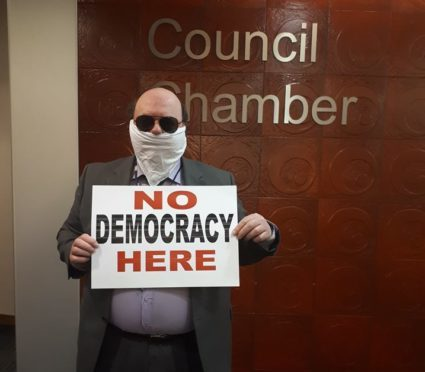 Peterhead councillor Alan Buchan staged a protest