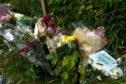 Flowers left at the scene of a dead 14-year-old boy near Hillside School. Portlethen.