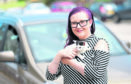 Pictured are Zoe Duncan and Heidi the kitten which had to be rescued by firefighters after becoming stuck in the dashboard of a car. Picture by DARRELL BENNS     Pictured on 15/07/2018
