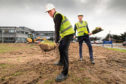 Alan Kennedy and Diageo International supply centre director Ewan Andrew break ground at the site in Menstrie