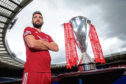 Graeme Shinnie with the SPFL Trophy during the Scottish Premiership launch at Hampden Park, Glasgow.