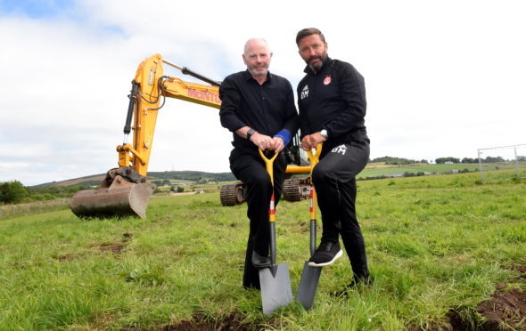 Stewart Milne and Derek McInnes broke ground on the training complex at Kingsford yesterday.