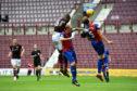Uche Ikpeazu heads in Hearts' third goal.