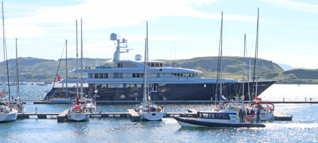 86M Long super yacht Archimedes lies against the breakwater Oban bay.