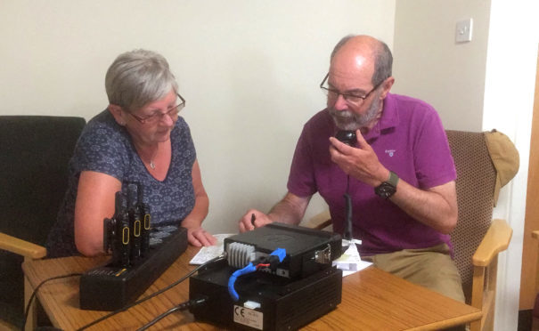Linda Drever and John Bolton with the new radio system which will keep Ballater residents safe.