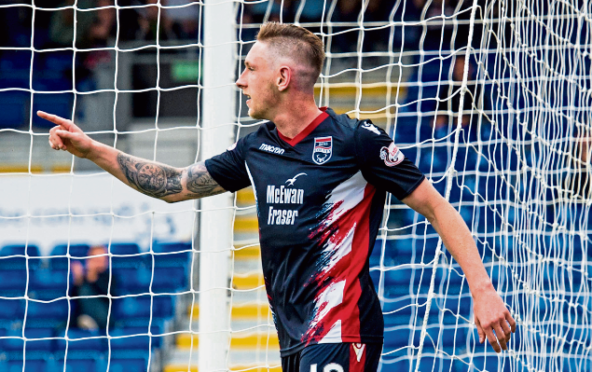 Declan McManus celebrates after making it 1-0 for Ross County