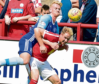 Russell McLean, left, tussles with Brechin City's Euan Spark
