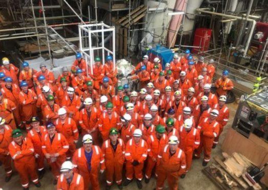 Workers on the Mariner platform last week.