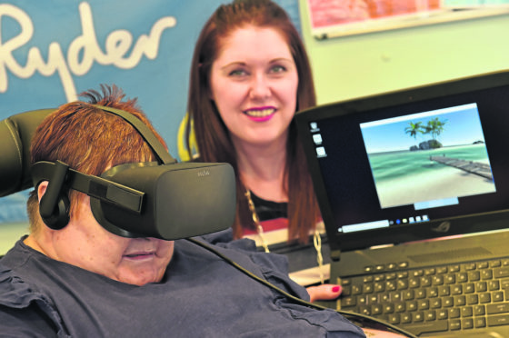 Sue Ryder in Kincorth has unveiled new virtual reality kits for its residents. Picture of (L-R) resident Kathleen Robertson and manager Emma Leiper Finlayson.  Picture by Kenny Elrick.