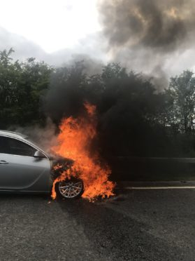 Car on fire on the A96. Picture taken by Jim Duff.