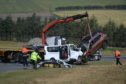 The removal of the two vehicles taking place on the A96.