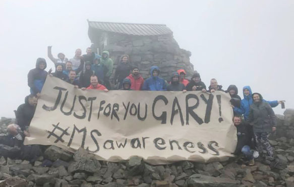The team who set up a food stop on the summit of Ben Nevis to raise money for Gary Campbell's MS stem cell treatment.