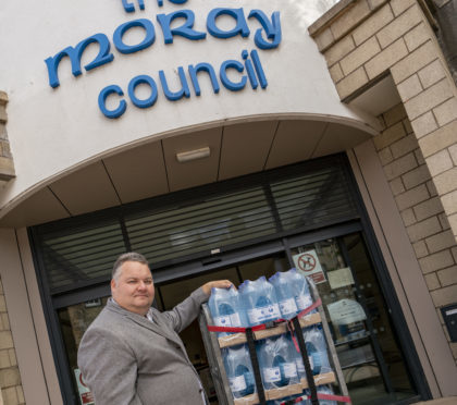 Lead Councilor Graham Leadbitter, with a water supplies.