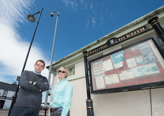 Conservative MP Douglass Ross with Jane Wilson from Fife Keith Action Group underneath the Keith CCTV cameras Picture by Jason Hedges