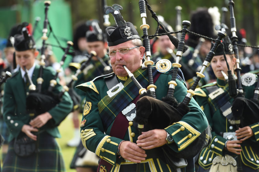 Picture by JASON HEDGES   Pictures show the sporting events of Tomintoul, 2018 Highland Games.  Picture: Pipe Bands Perform