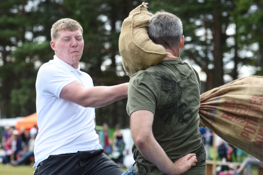 Picture by JASON HEDGES   Pictures show the sporting events of Tomintoul, 2018 Highland Games.  Picture: Charlie Mitchell (white) goes all out to win this years Pillow Fight!