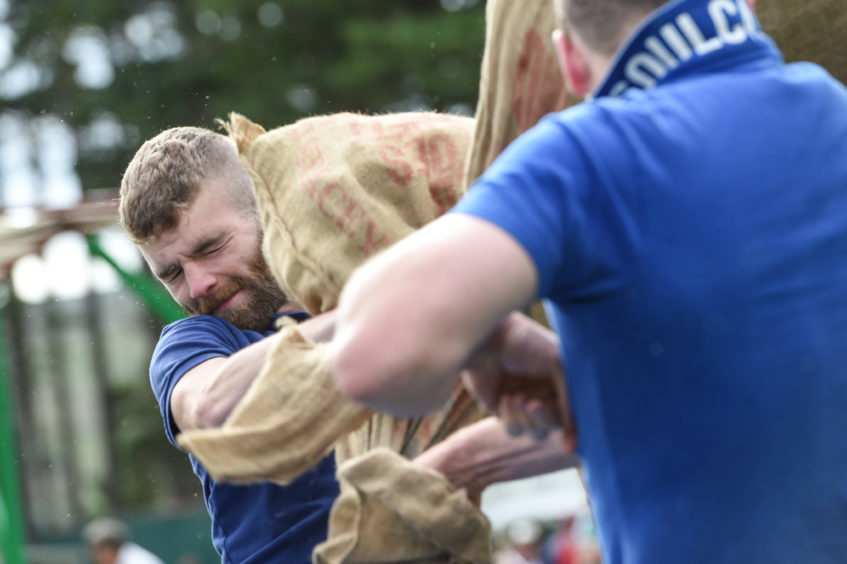 Picture by JASON HEDGES   Pictures show the sporting events of Tomintoul, 2018 Highland Games.  Picture: Competitors fight it out in the Pillow Fight.