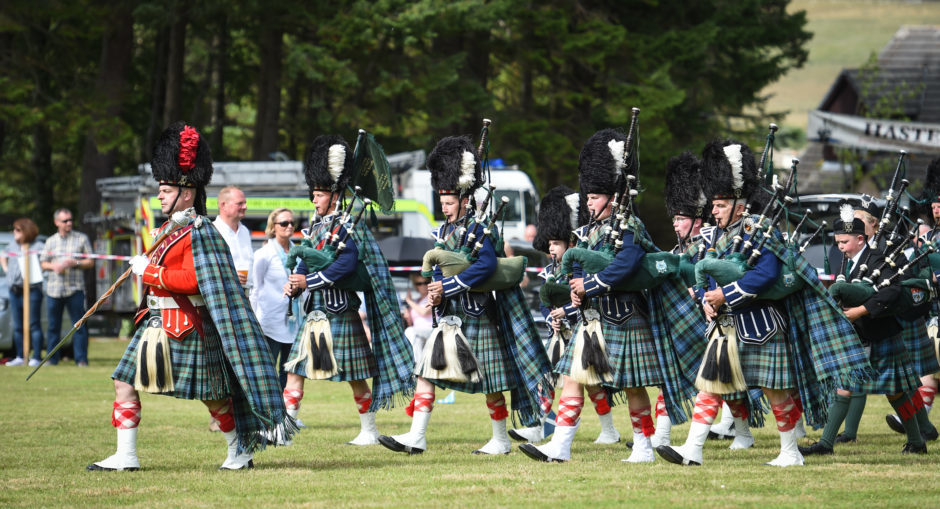 Picture by JASON HEDGES   Pictures show the sporting events of Tomintoul, 2018 Highland Games.  Picture: Ballater and distict pipe band plays.