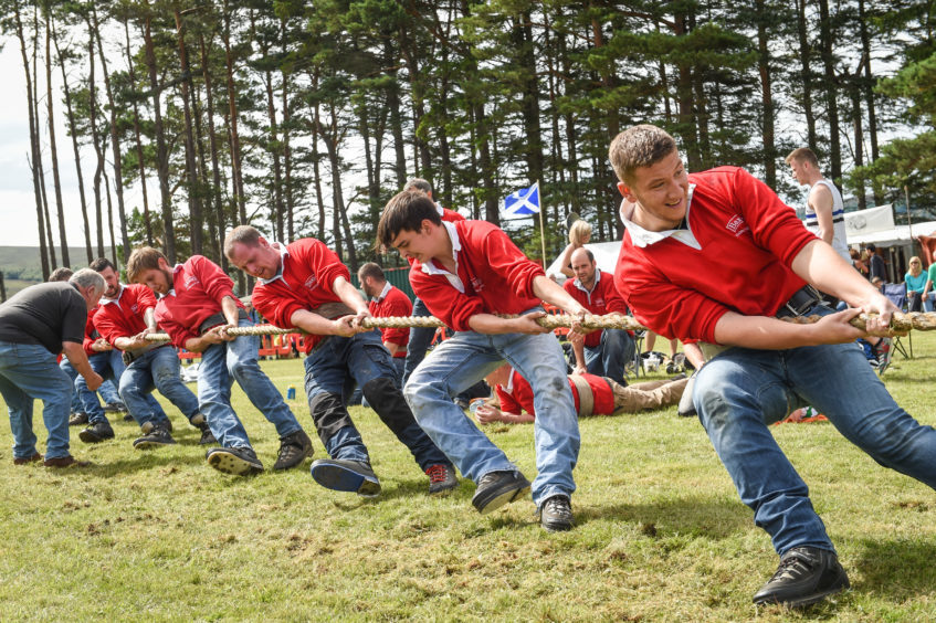 Picture by JASON HEDGES   Pictures show the sporting events of Tomintoul, 2018 Highland Games.  Picture: Elgin Tug-of-War team in action! This picture they win against Strathdee.