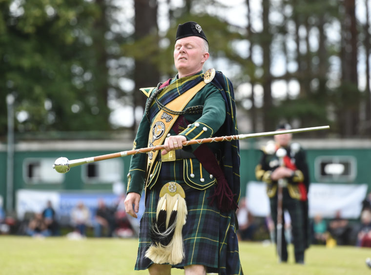 Picture by JASON HEDGES   Pictures show the sporting events of Tomintoul, 2018 Highland Games.  Picture: Derek Dean from Huntly winds the Drum Majors Challenge.