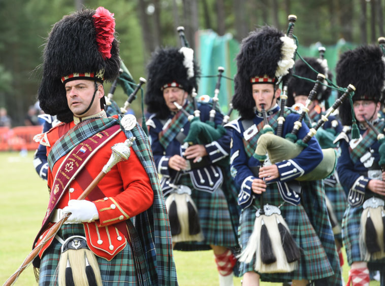 Picture by JASON HEDGES   Pictures show the sporting events of Tomintoul, 2018 Highland Games.  Picture: Ballater & District Pipe Band