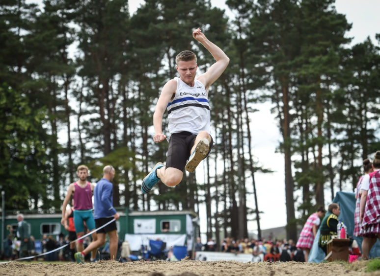 Picture by JASON HEDGES   Pictures show the sporting events of Tomintoul, 2018 Highland Games.  Picture: Findlay Donegal from Elgin wins Tripple Jump!