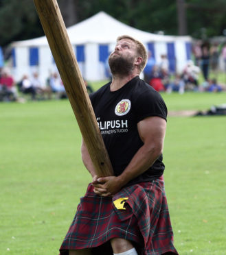 A delighted Scott Ryder England World Champion Caber Tosser Inveraray Highland games.  Scott lost his title to Lorne Colthart from Blair Atholl in 2017 but was delighted to win back the title for 2018.