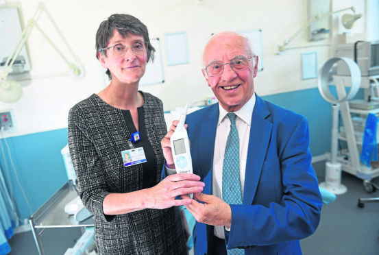 Pictured from left, Professor Maggie Cruickshank and Willie Henderson with the ZedScan diagnostic devices.  Picture by Darrell Benns