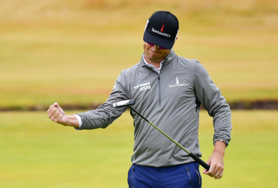 Zach Johnson  celebrates a birdie on the 18th green during the second round of the 147th Open.