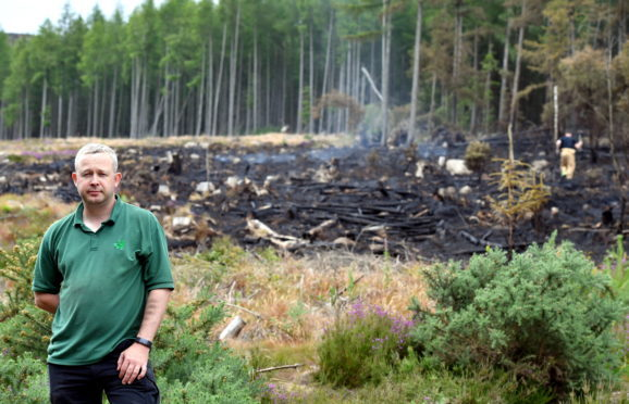 Dan Cadle of Forrest Enterprise Scotland at the scene of a gorse fire on the walk to the Mither Tap at Bennachie from the visitor centre.   Picture by Kami Thomson    08-07-18