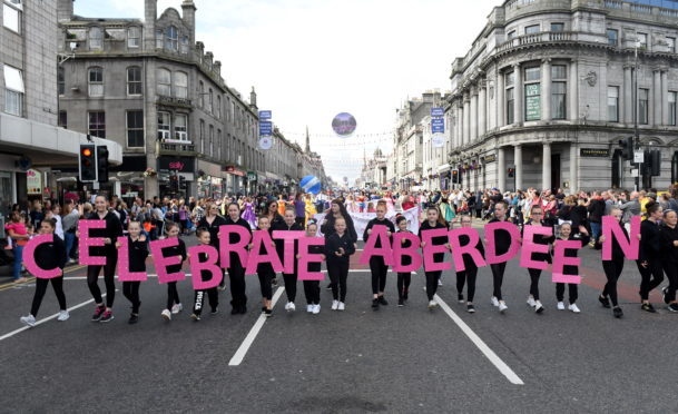 Volunteers walk down Union Street to mark Celebrate Aberdeen.